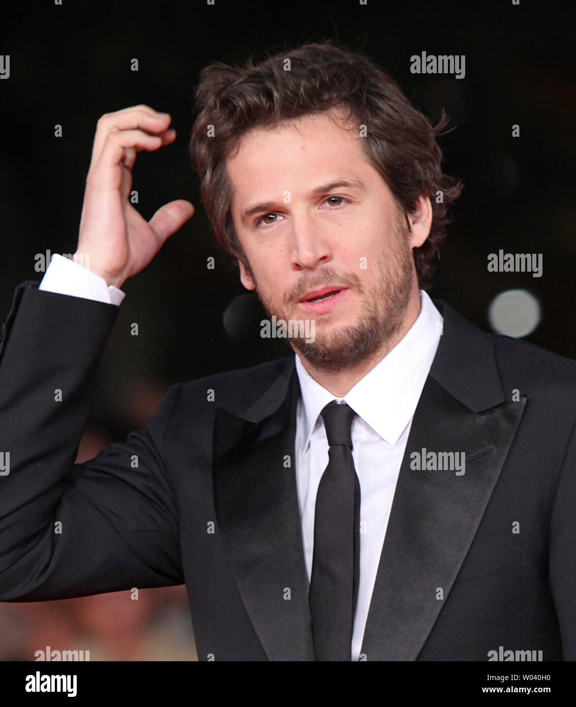 Guillaume Canet arrives on the red carpet before the screening of a digitally restored version of the 1960 classic film 'La Dolce Vita' during the 5th Rome International Film Festival in Rome on October 30, 2010.   UPI/David Silpa - Stock Image