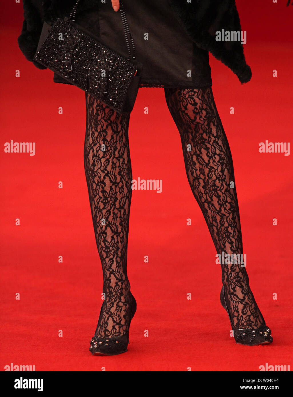 A festival attendee arrives on the red carpet before the screening of a digitally restored version of the 1960 classic film 'La Dolce Vita' during the 5th Rome International Film Festival in Rome on October 30, 2010.   UPI/David Silpa - Stock Image