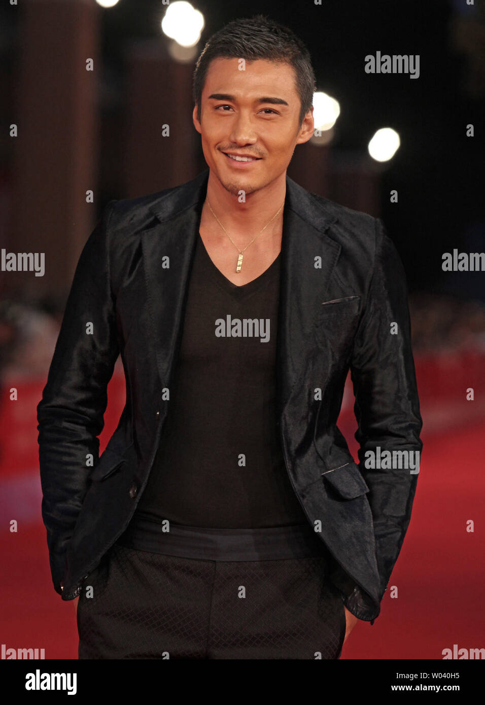 Hu Bing arrives on the red carpet before the screening of a digitally restored version of the 1960 classic film 'La Dolce Vita' during the 5th Rome International Film Festival in Rome on October 30, 2010.   UPI/David Silpa - Stock Image
