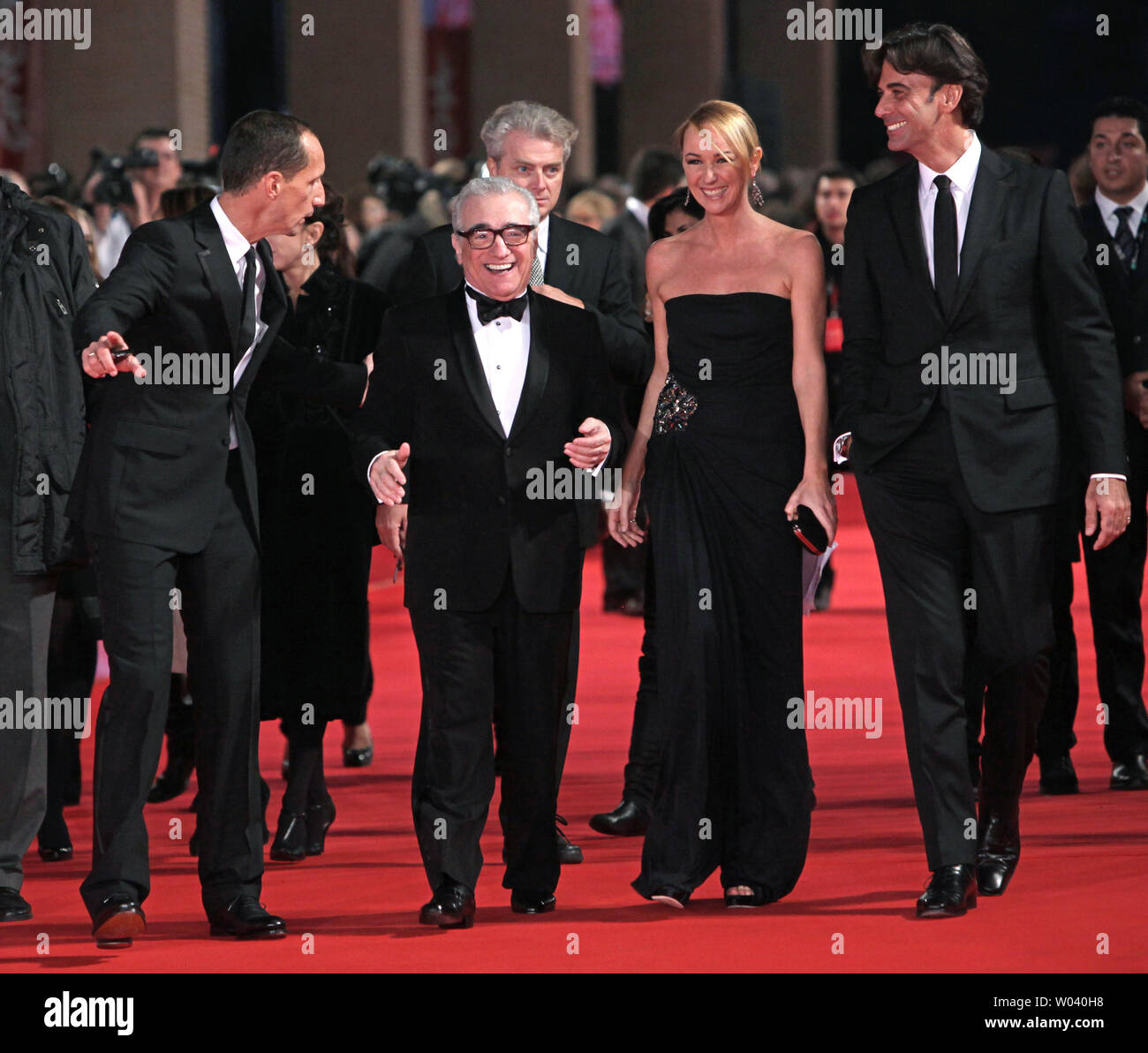 Martin Scorsese (C) leads a delegation down the red carpet before the screening of a digitally restored version of the 1960 classic film 'La Dolce Vita' during the 5th Rome International Film Festival in Rome on October 30, 2010.   UPI/David Silpa - Stock Image