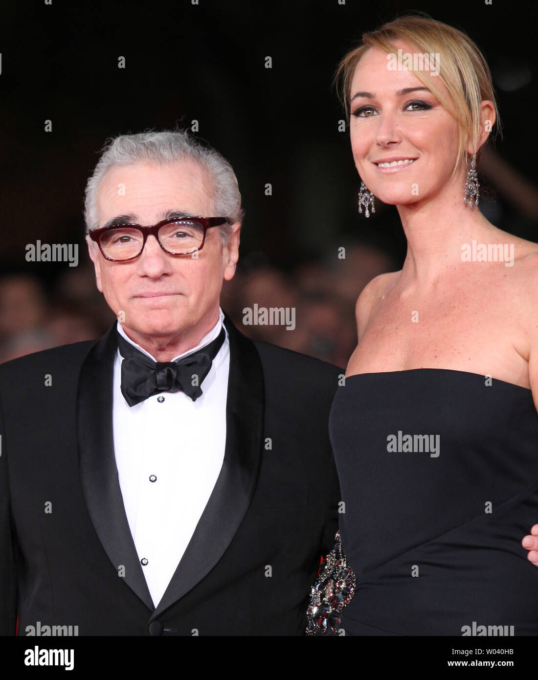 Martin Scorsese (L) and Frida Giannini arrive on the red carpet before the screening of a digitally restored version of the 1960 classic film 'La Dolce Vita' during the 5th Rome International Film Festival in Rome on October 30, 2010.   UPI/David Silpa - Stock Image