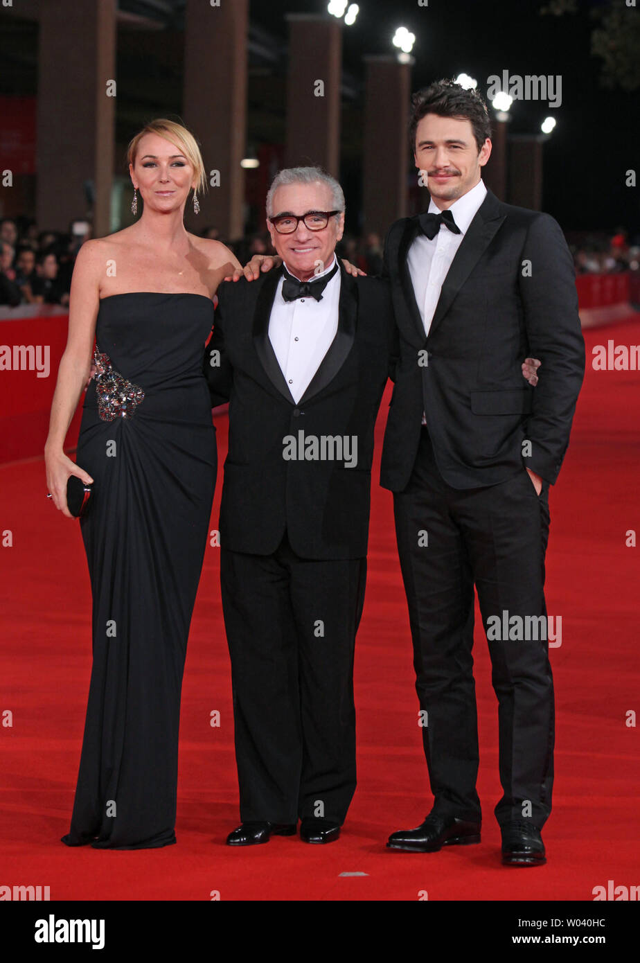 Frida Giannini (L), Martin Scorsese (C) and James Franco arrive on the red carpet before the screening of a digitally restored version of the 1960 classic film 'La Dolce Vita' during the 5th Rome International Film Festival in Rome on October 30, 2010.   UPI/David Silpa - Stock Image