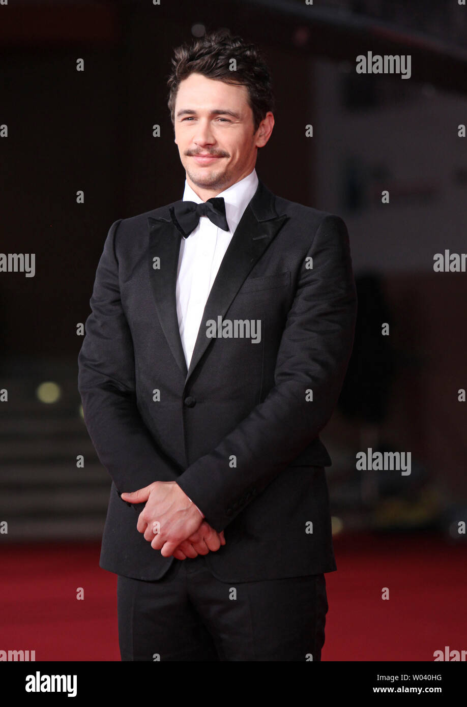 James Franco arrives on the red carpet before the screening of a digitally restored version of the 1960 classic film 'La Dolce Vita' during the 5th Rome International Film Festival in Rome on October 30, 2010.   UPI/David Silpa - Stock Image