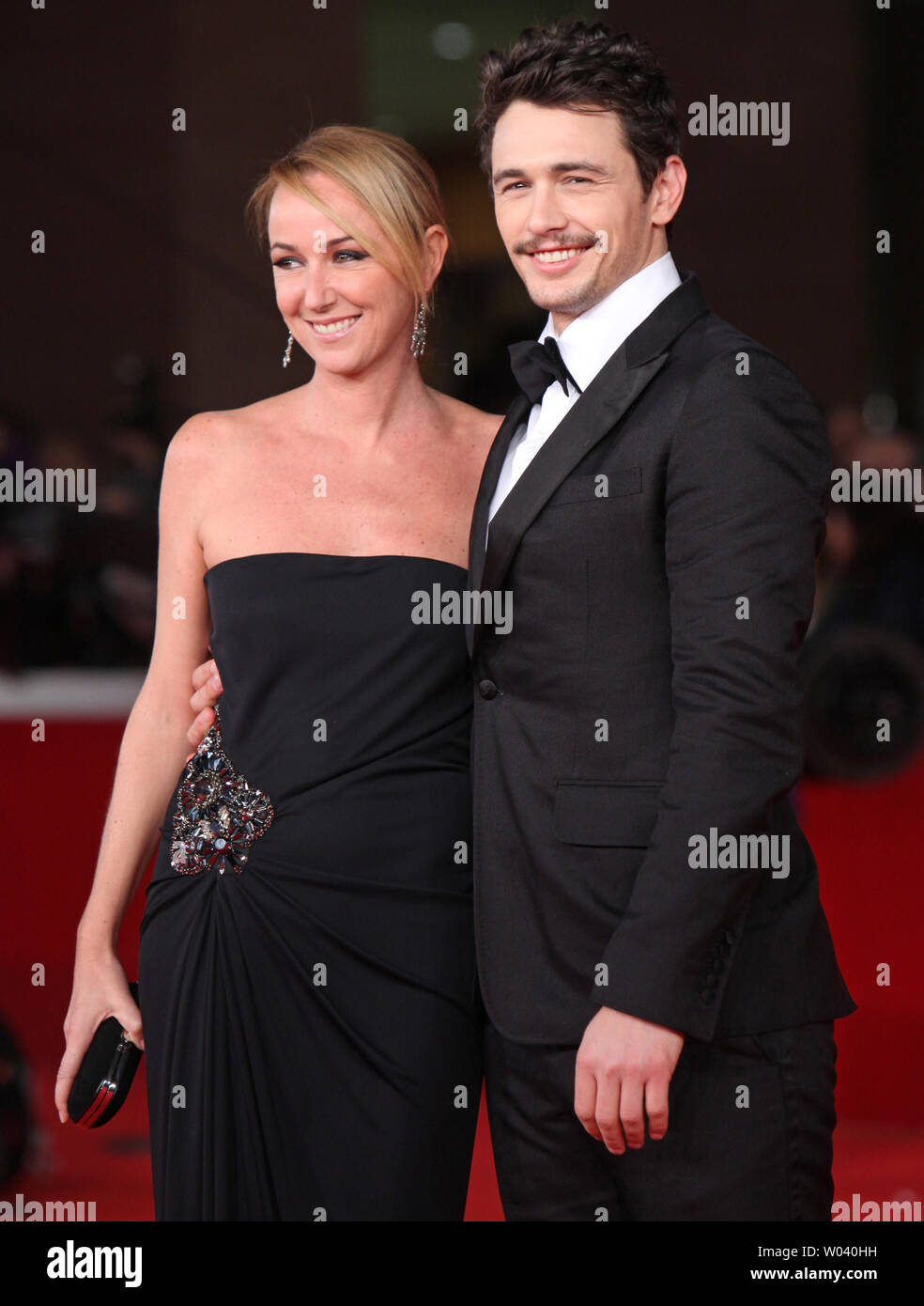 Frida Giannini (L) and James Franco arrive on the red carpet before the screening of a digitally restored version of the 1960 classic film 'La Dolce Vita' during the 5th Rome International Film Festival in Rome on October 30, 2010.   UPI/David Silpa - Stock Image