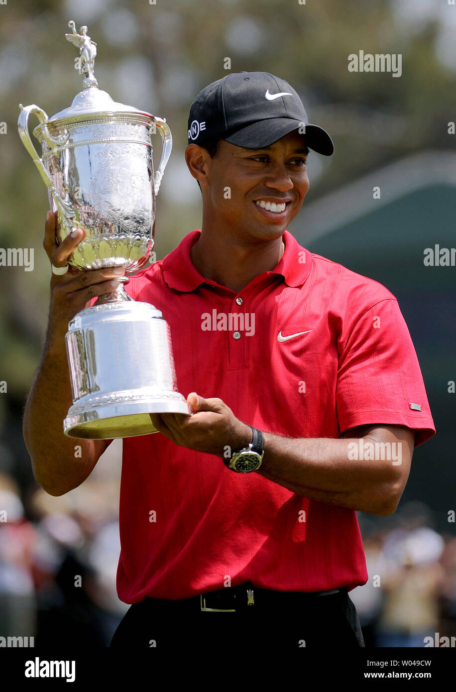 Tiger Woods hold the U.S. Open Trophy after winning the 108th U.S. Open  at Torrey Pines Golf Course in San Diego on June 16, 2008. Woods defeated Rocco Mediate by one stroke after a playoff round. (UPI Photo/Kevin Dietsch) Stock Photo