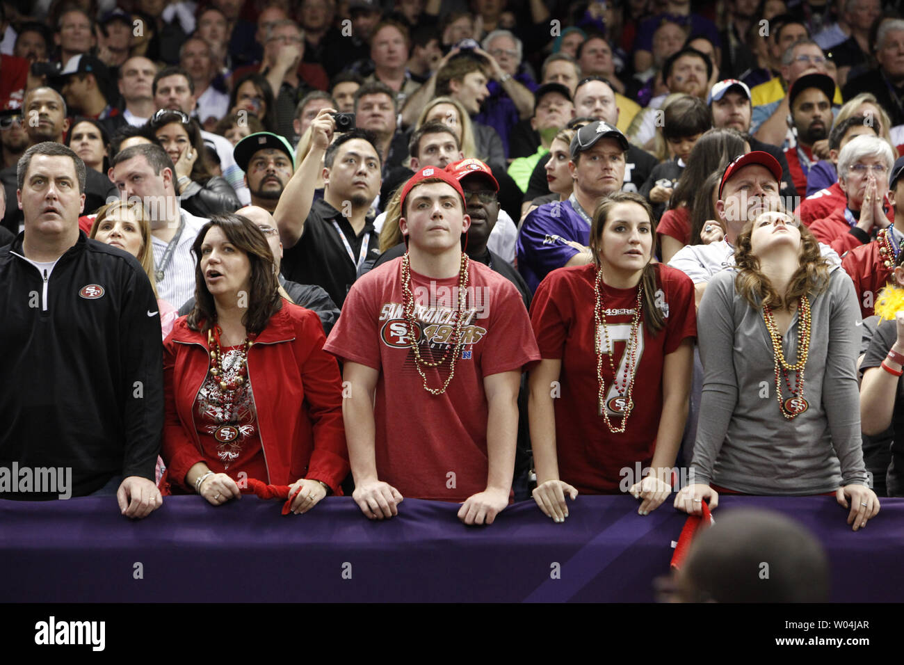 San Francisco 49er fans watch the final seconds as their team loses to the Baltimore Ravens at the Mercedes-Benz Superdome on February 3, 2013 in New Orleans.  UPI/Bevil Knapp - Stock Image