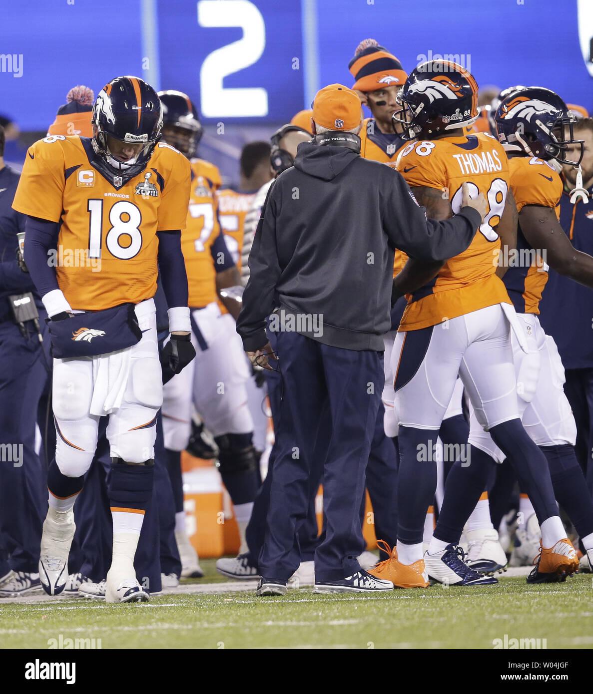 timeless design b8cf8 d66b3 Denver Broncos quarterback Peyton Manning (18) returns to ...