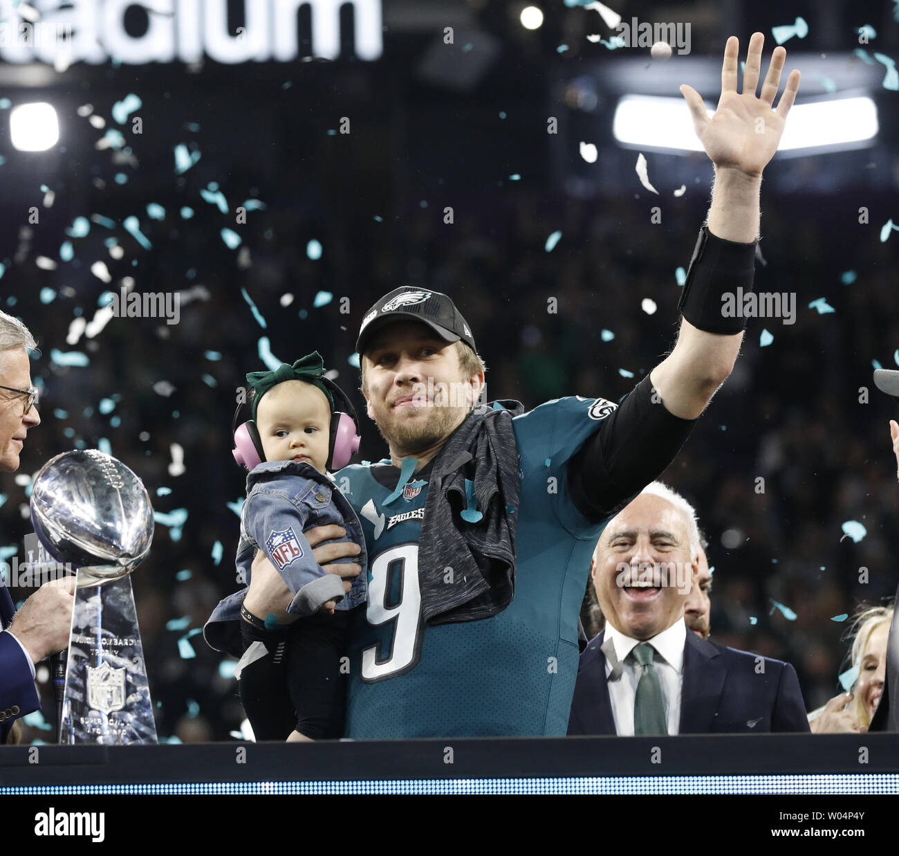 Philadelphia Eagles quarterback Nick Foles (9) waves as he holds his daughter, Lily James, after Super Bowl LII at U.S. Bank Stadium in Minneapolis, Minnesota on February 4, 2018.  The Philadelphia Eagles won 41-33 for their first Super Bowl in 52 years.  Photo by John Angelillo/UPI - Stock Image