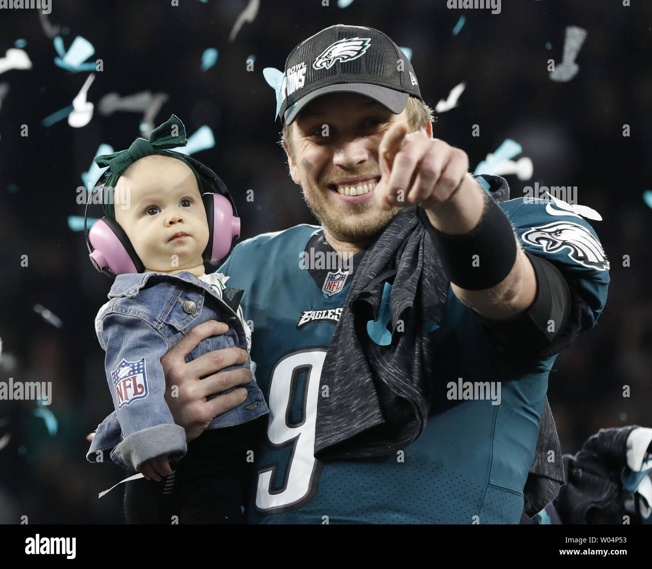 Philadelphia Eagles quarterback Nick Foles (9) reacts as he holds his daughter, Lily James, after Super Bowl LII at U.S. Bank Stadium in Minneapolis, Minnesota on February 4, 2018.  The Philadelphia Eagles won 41-33 for their first Super Bowl in 52 years.  Photo by John Angelillo/UPI - Stock Image
