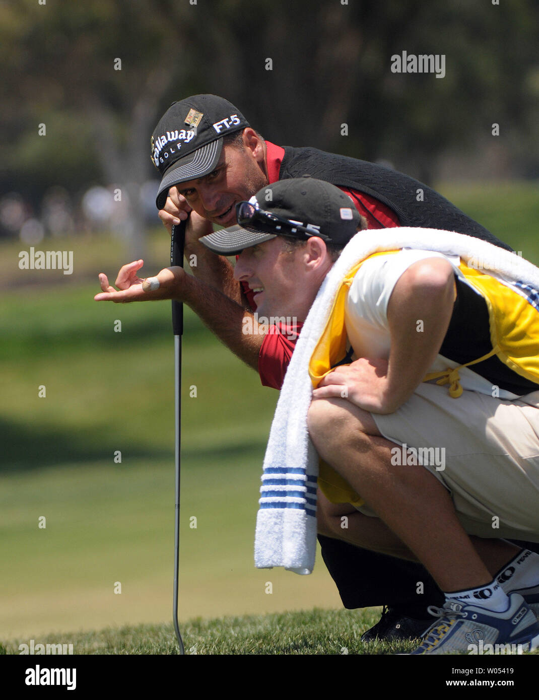 Rocco Mediate (L) and caddie Matt Achatz discuss the sudden death shot on the 7th hole of the playoff round of the US Open at Torrey Pines Golf Course in San Diego on June 16, 2008. Tiger Woods went on to win the 108th US Open. (UPI Photo/Earl S. Cryer) Stock Photo
