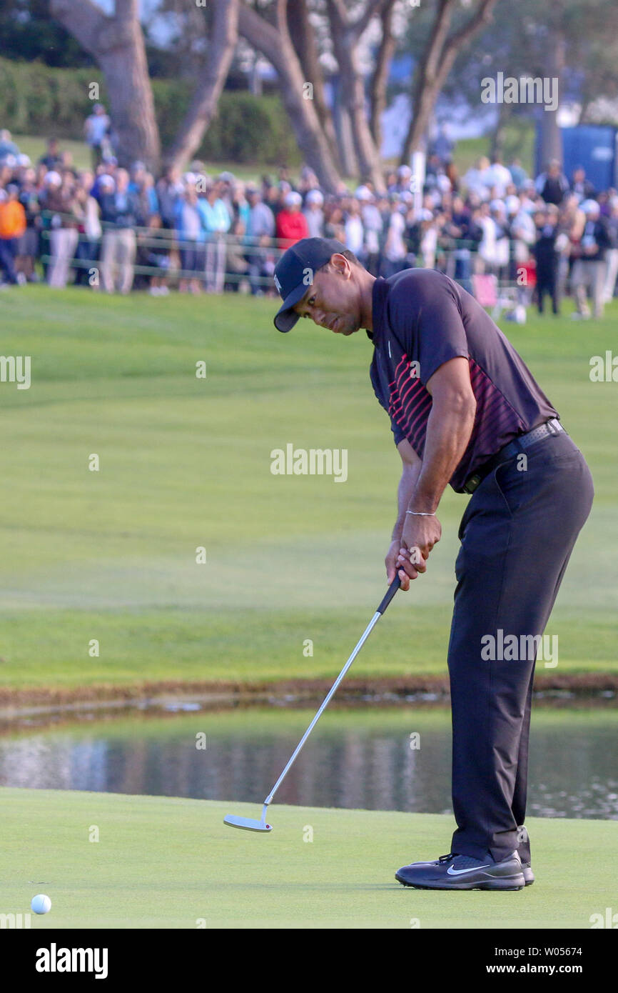 Tiger Woods putts on the 18th green during the first round of the Farmers Insurance Open at Torrey Pines in San Diego, California on January 25, 2018. Woods, the former No. 1 golfer in the world is making his latest PGA comeback at the tournament. This will be the first time Woods has played at a PGA event since his back surgery 10 months ago that sidelined his comeback attempt last year.   Photo by Howard Shen/UPI - Stock Image