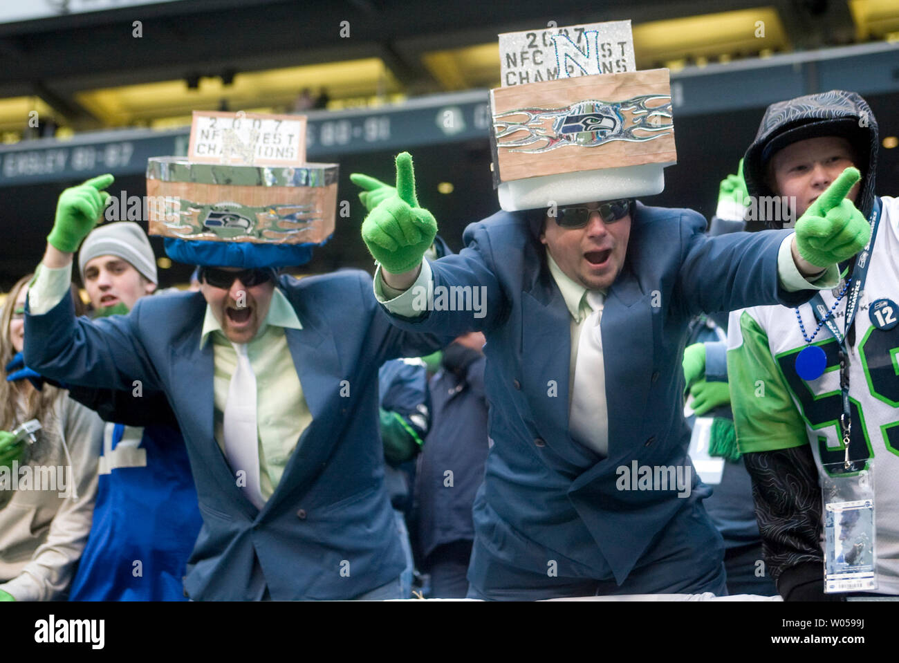 Seattle Seahawks fans Jason Wright (L ) and Kevin Martin (R) wear NFC Championship hats as the Seahawks beat the Arizona Cardinals 42-21 at Qwest Field in Seattle on December 9, 2007 to earn their fifth straight Western Divison Championships. (UPI Photo/Jim Bryant). - Stock Image