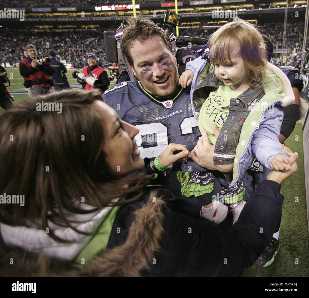 Seattle Seahawks defensive tackle Craig Terrill celebrates with his family their 41-36 win over the defending Super Bowl Champion New Orleans Saints in the NFC's wild-card playoff game on Saturday January 8, 2011 at Qwest Field in Seattle.  (UPI /Jim Bryant) Stock Photo