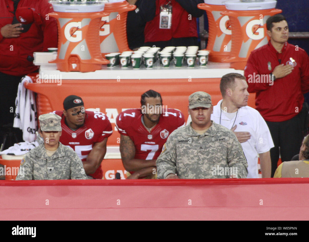 San Francisco 49ers QB Colin Kaepernick (7) kneels alongside teammate Eric Reid during the National Anthem before playing the Los Angeles Rams at Levi's Stadium in Santa Clara, California on September 12. 2016. Kaepernick and Reid are kneeling In a protest of racial injustice.   Photo by Bruce Gordon/UPI Stock Photo