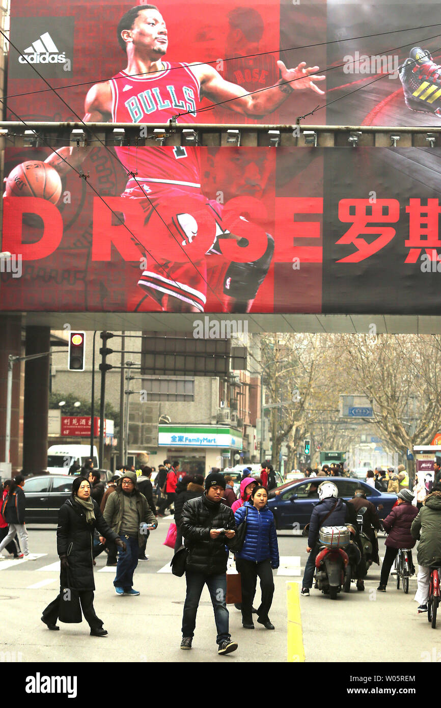 Chinese Walk Past A Giant Adidas Advertisement Promoting Its Sporting Goods And The Nba In Shanghai On February 2 2015 Many Multinational Sporting Goods Companies Support And Sponsor The Nba The Most