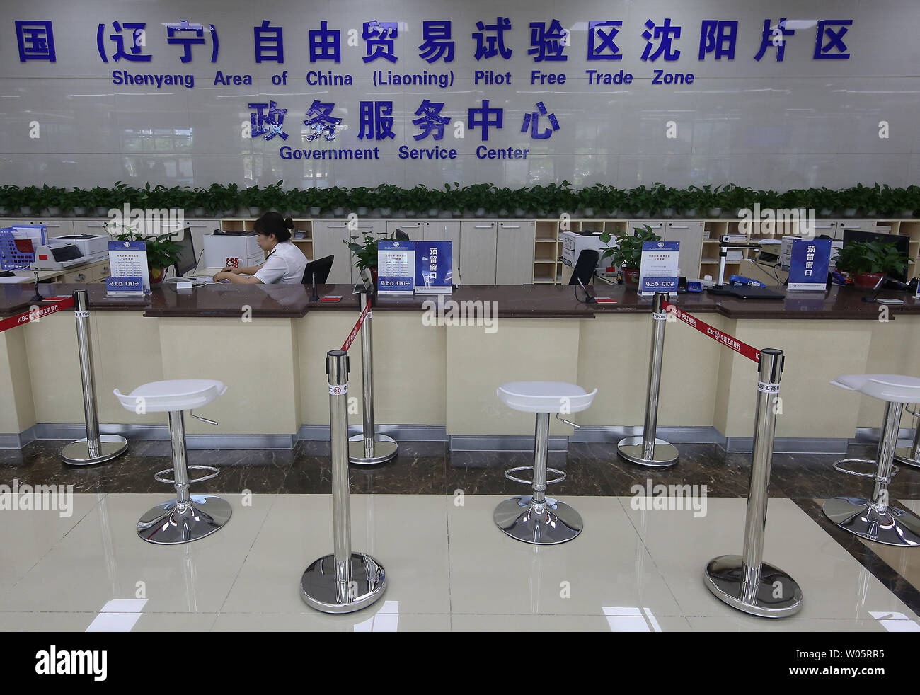 A lone government employee waits for customers at Shenyang's