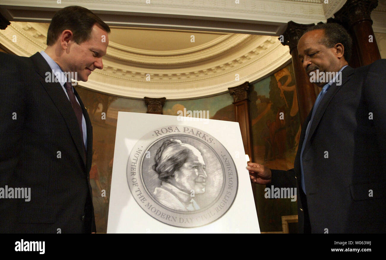 """St. Louis Mayor Francis Slay (L) and Harold Crumpton, president of the St. Louis NAACP, talk about details of a ceremony that will celebrate the life of  """"The Mother of the Modern Day Civil Rights Movement,"""" Rosa Parks, in St. Louis on November 28, 2005. The ceremony will be held on  December 1, the same day Parks was arrested for not giving up her seat on a city bus to a white man in Montgomery, AL in 1955. (UPI Photo/Bill Greenblatt) Stock Photo"""