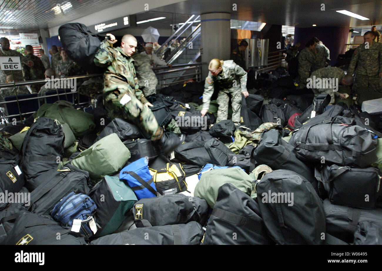 93789fdf Solider Carl Honsaker of New York steps over hundreds of duffel bags after  finding his own