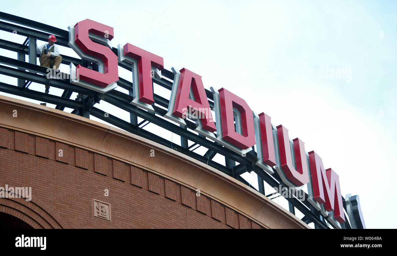 A construction worker waits atop the new Busch Stadium for the next letter as the main sign at the new St. Louis Cardinals home is installed in St. Louis on December 27, 2005. The Cardinals are expected to play their home opener in the new facility on April 10, 2006. (UPI Photo/Bill Greenblatt) - Stock Image