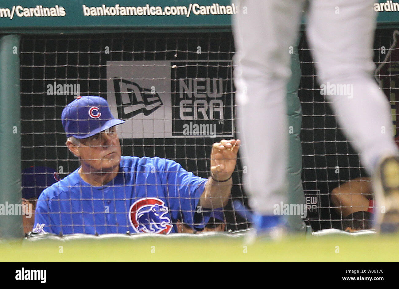 Chicago Cubs manager Lou Pinella looks on as pitching coach Larry Rothschild returns to the dugout after talking to pitcher Justin Berg in the seventh inning at Busch Stadium in St. Louis on August 13, 2010. St. Louis won the game 6-3. UPI/Bill Greenblatt - Stock Image