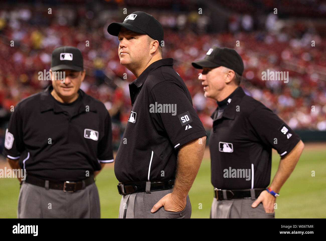 572bb07115a308 Umpires Ron Kulpa (C) Ed Rapuano (L) and Lance Barksdale stand at