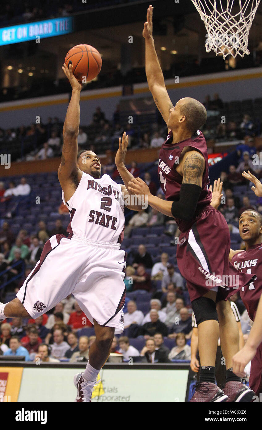 Missouri State Bears Nafis Ricks (2) tries to get by Southern Illinois Salukis John Freeman in the first half of the Missouri Valley Conference Tournament at the Scottrade Center in St. Louis on March 4, 2011. UPI/Bill Greenblatt Stock Photo