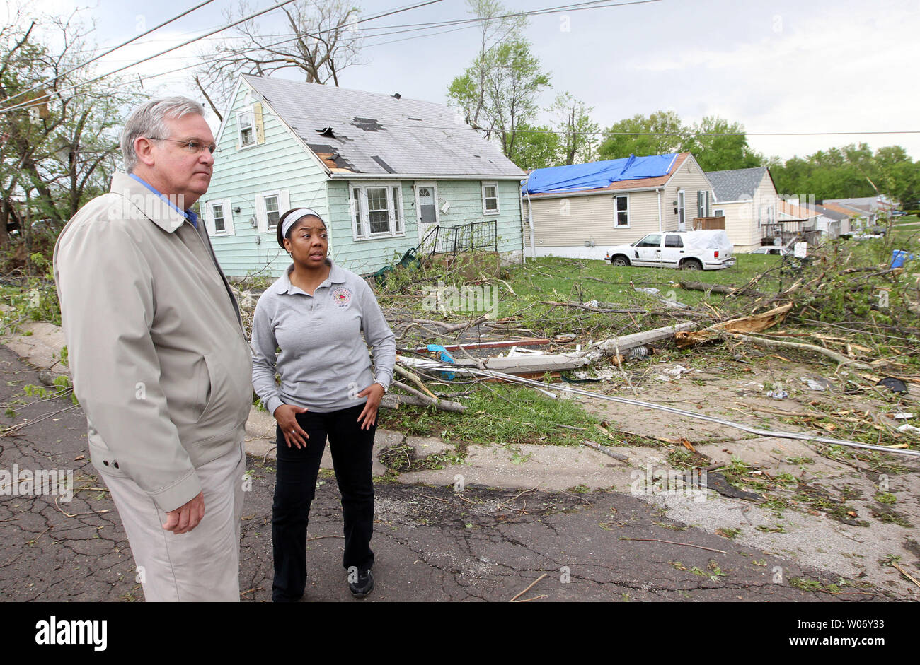 Missouri Governor Jay Nixon gets a tour of a damaged neighborhood by Berkeley, Missouri Mayor Kyra Watson in St. Louis on April 23, 2011. A F-4 tornado hit the region on 4/22 damaging or destroying over 750 homes and buildings.  UPI/Bill Greenblatt Stock Photo