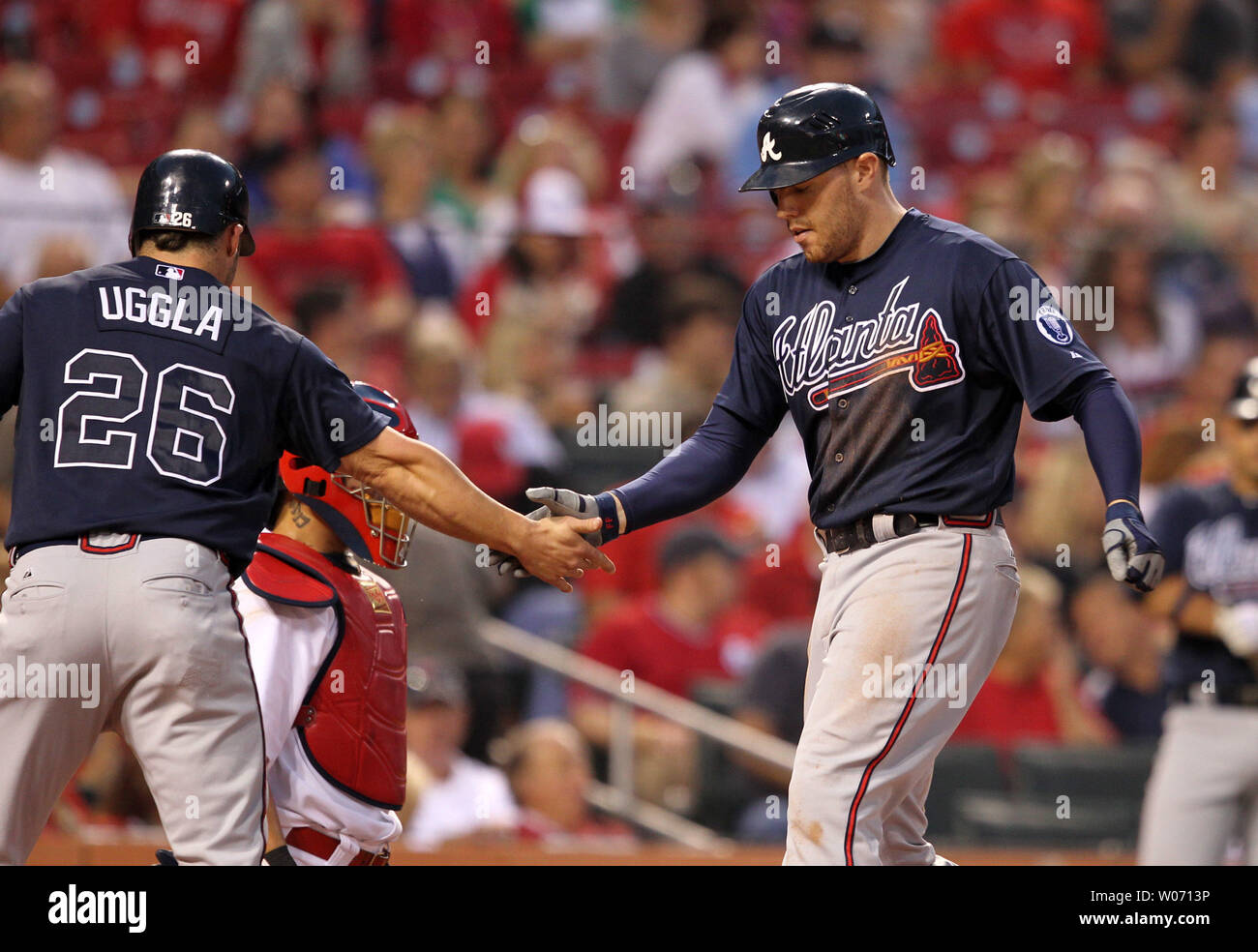 Atlanta Braves Freddie Freeman is congratulated at home plate by Dan Uggla after hitting a two run home run in the fourth inning against the St. Louis Cardinals at Busch Stadium in St. Louis  on September 10, 2011.  UPI/Bill Greenblatt Stock Photo