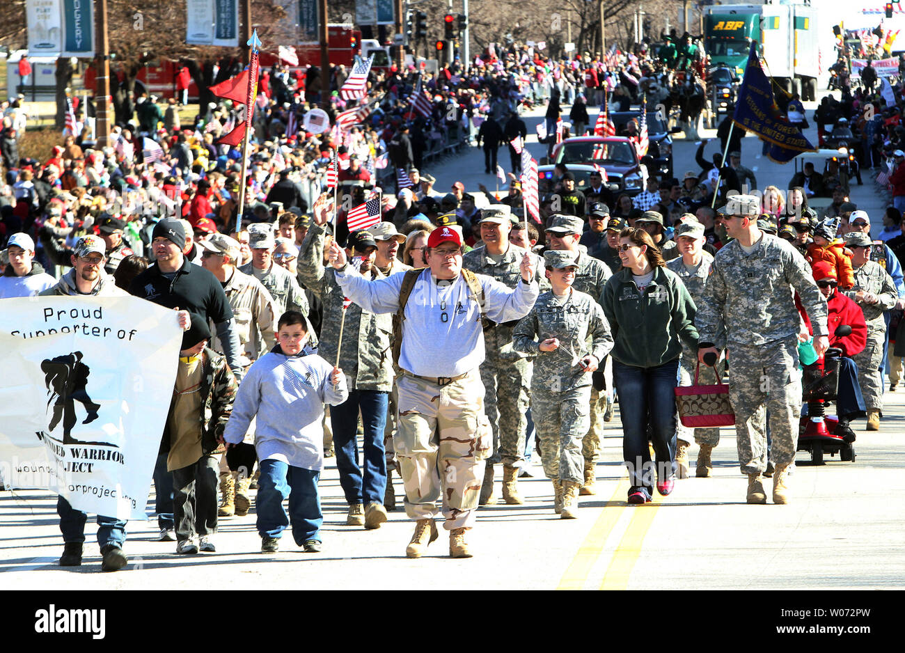 Veterans march in a parade in St. Louis on January 28, 2012. Thousands of people lined a parade route in downtown St. Louis for the nationÕs first parade to honor those who have served in Iraq and Afghanistan. UPI/Bill Greenblatt - Stock Image