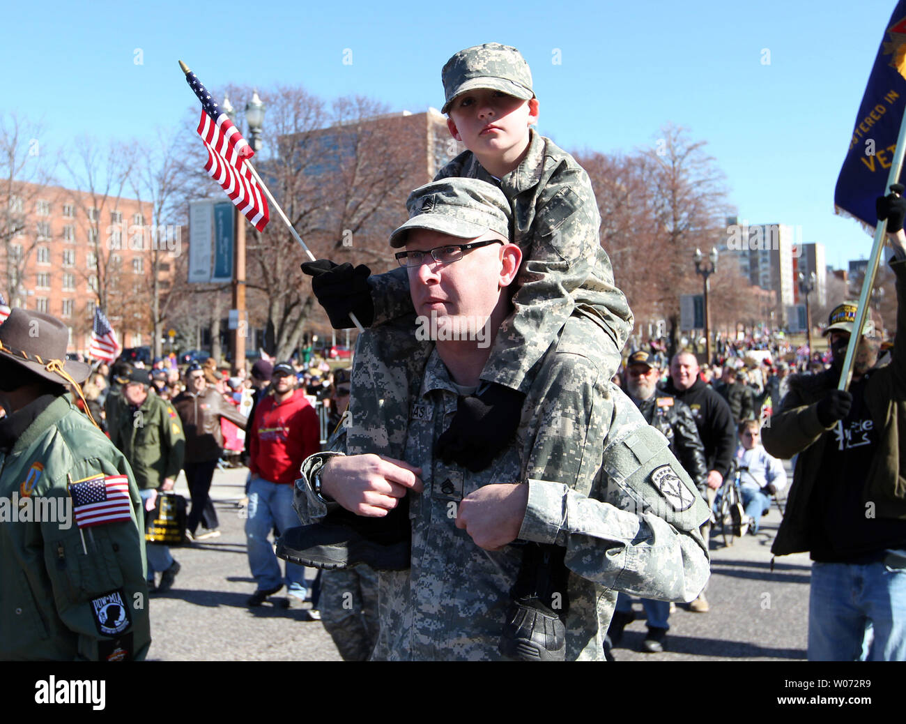Veterans march during a parade in St. Louis on January 28, 2012. Thousands of people lined a parade route in downtown St. Louis for the nationÕs first parade to honor those who have served in Iraq and Afghanistan. UPI/Bill Greenblatt - Stock Image