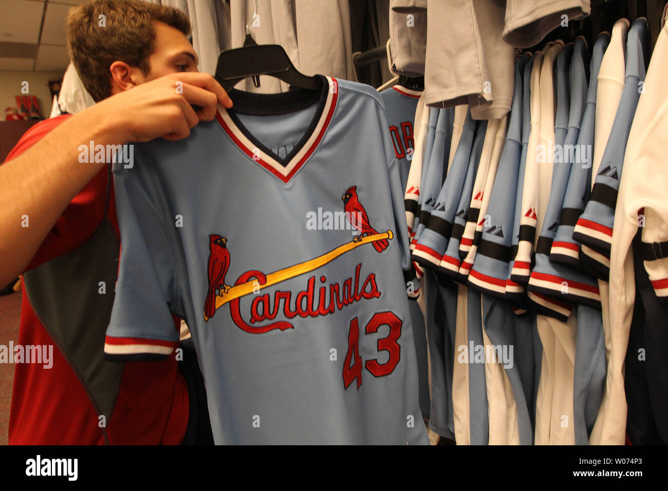 best service 6f724 6e0ed St. Louis Cardinals clubhouse attendant Greg Ginos places ...