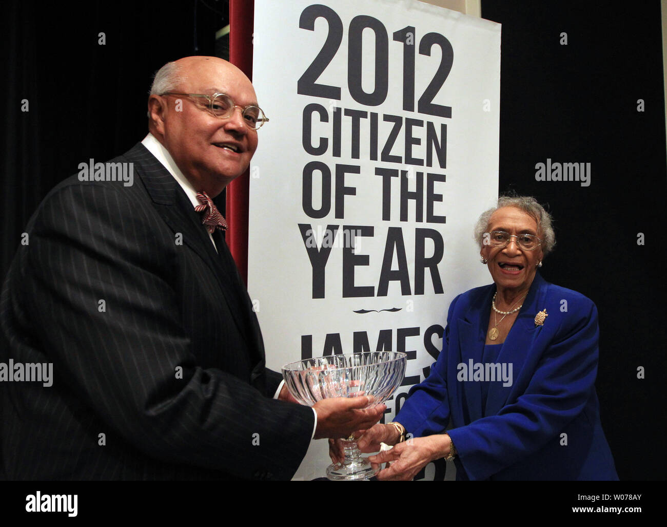 James Buford, President and CEO of the Urban League of St. Louis accepts his award after being named 2012 St. Louis Citizen of the Year from last year's winner civil rights attorney Frankie Freeman in St. Louis on April 29, 2013. UPI/Bill Greenblatt Stock Photo