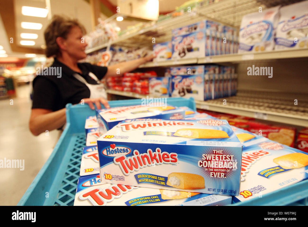 Lori Silvey, assistant bakery manager, stocks the shelves
