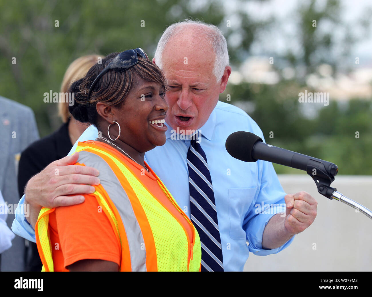 Illinois Governor Pat Quinn joins Illinois Department Transportation worker Theresa Foote as they talk about the diverse workforce that have worked on Mississippi River Bridge in Brooklyn, Illinois on July 15, 2013. The bridge will be named the Stan Musial Veterans Bridge, will connect Illinois to Missouri and has created 3,400 jobs. The bridge should be open by March 2014.    UPI/Bill Greenblatt Stock Photo