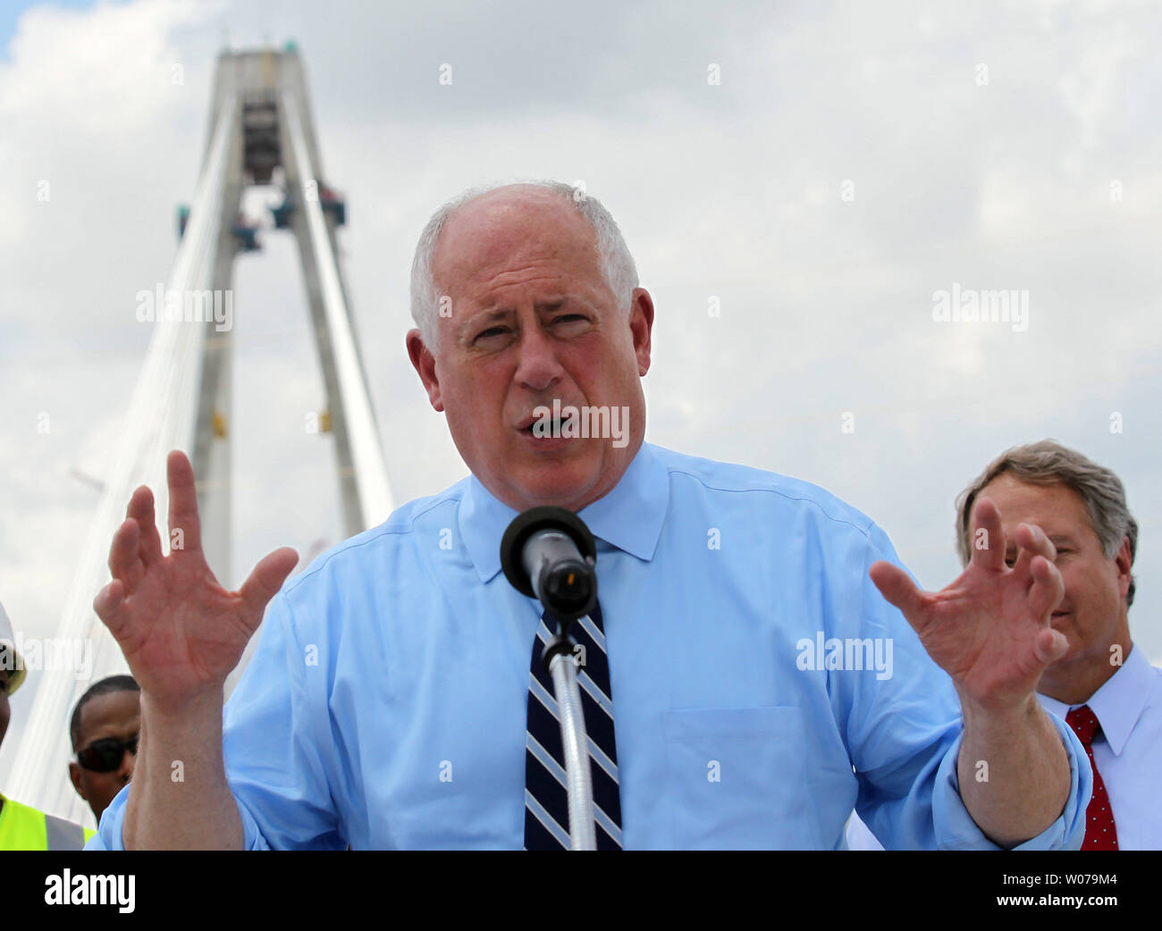 With a span of the new Stan Musial Veterans Bridge exposed, Illinois Governor Pat Quinn joins  workers to talk about the nearly completed bridge as preperations are being made for the final section in Brooklyn, Illinois on July 15, 2013. The bridge will connect Illinois to Missouri and has created 3,400 jobs. The bridge should be open by March 2014.    UPI/Bill Greenblatt Stock Photo