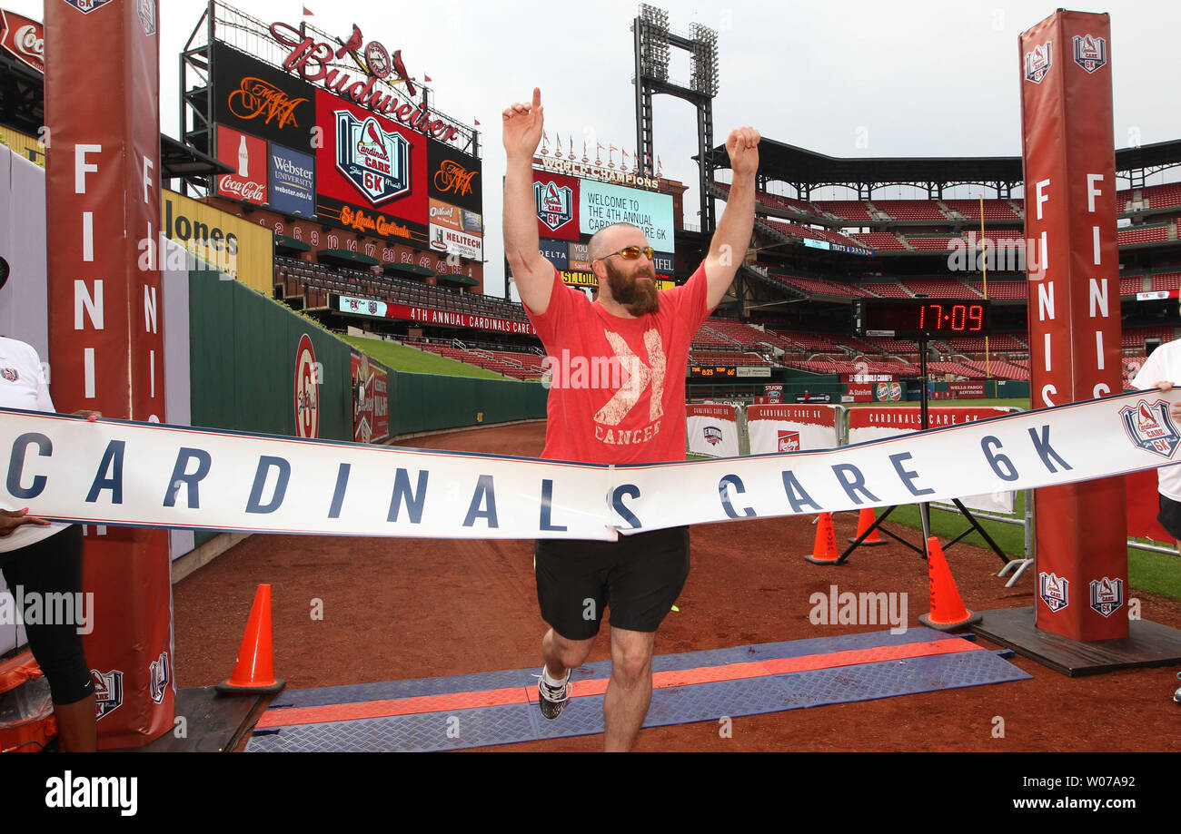 St. Louis Cardinals pitcher Jason Motte has fun testing out the finish line tape during the Fourth Annual Cardinals Care 6K run, at Busch Stadium in St. Louis on August 18, 2013. UPI/Bill Greenblatt - Stock Image