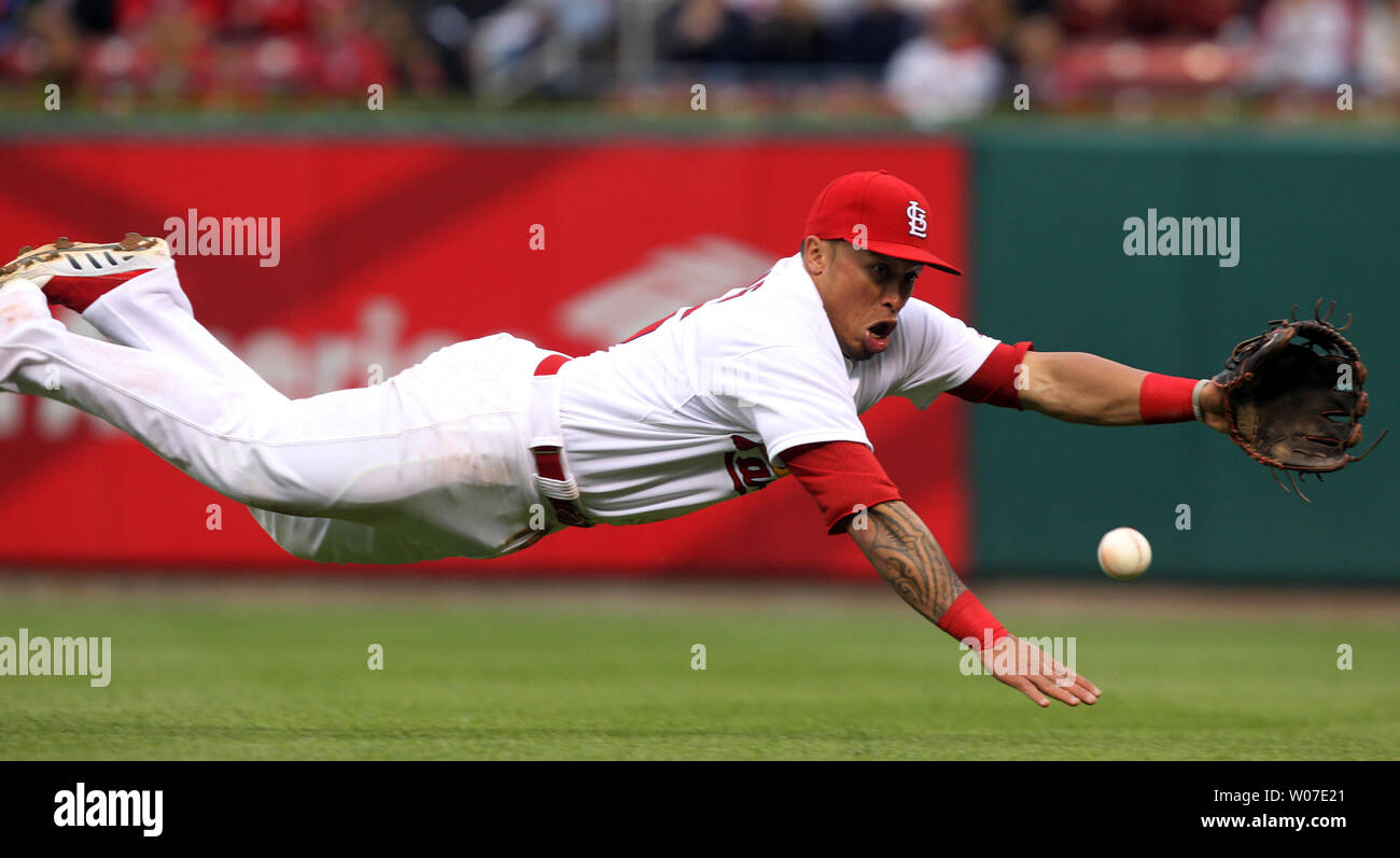 St. Louis Cardinals Kolten Wong makes a diving attempt for a ball hit by Atlanta Braves Freddie Freeman in the first inning at Busch Stadium in St. Louis on May 16, 2014.  The hit was good for a single.  UPI/Bill Greenblatt Stock Photo