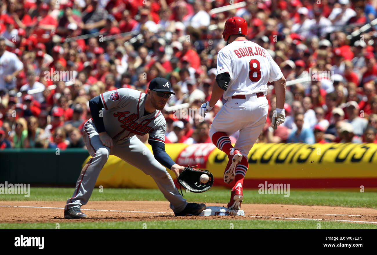 St. Louis Cardinals Peter Bourjos reaches first base on a wild pitch before Atlanta Braves first baseman Freddie Freeman can make the catch in the second inning at Busch Stadium in St. Louis on May 18, 2014.    UPI/Bill Greenblatt Stock Photo