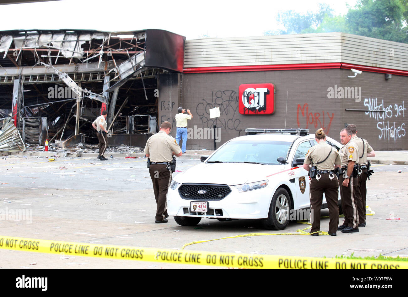 Members of the St. Louis County Police Department remain on the lot of the QuikTrip Gas station in Ferguson, Missouri on August 11, 2014. People are upset because of the Ferguson Police shooting and death of an unarmed black teenager Michael Brown on August 9, 2014. In all about 20 businesses sustained damage after a candlelight vigil turned violent.   UPI/Bill Greenblatt Stock Photo