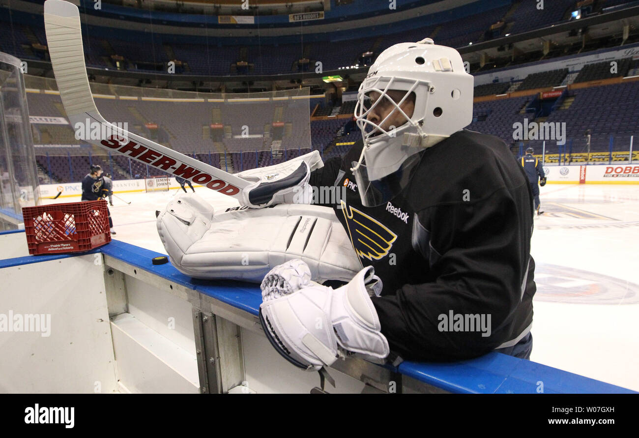 Goaltender Martin Brodeur Stretches On The Bench Before Practice As