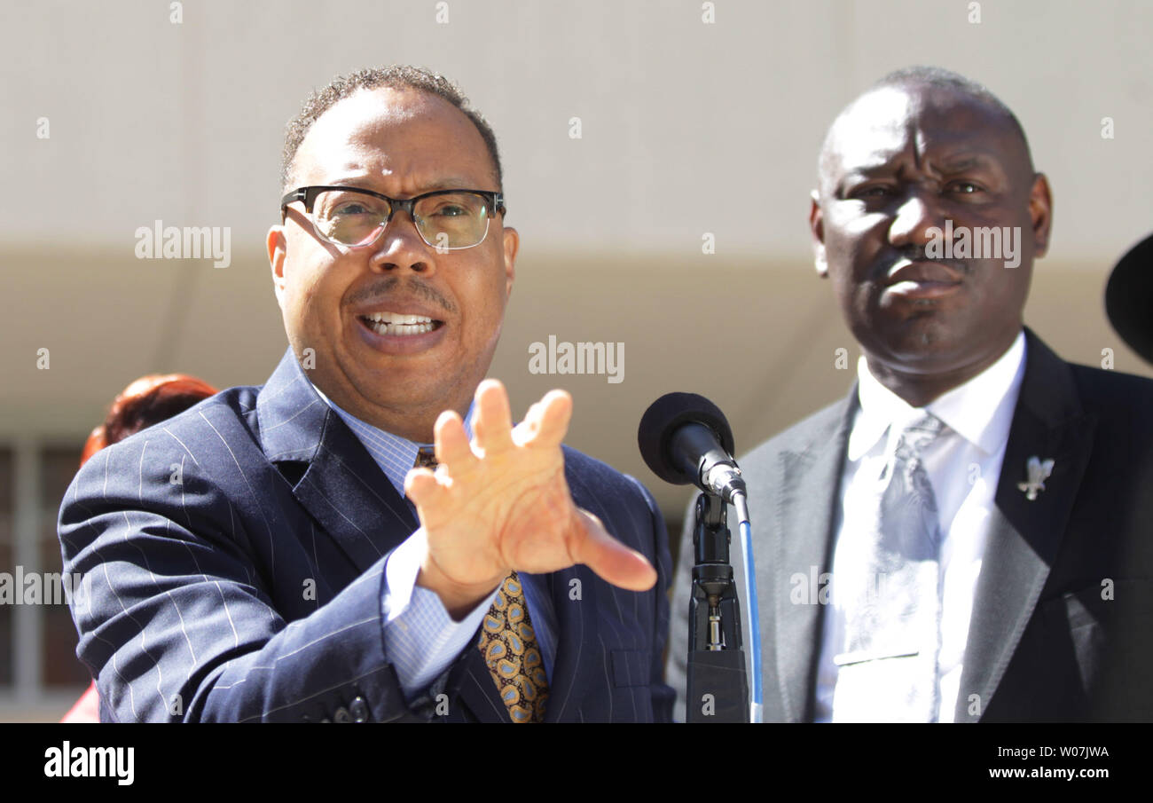 Family attorney Anthony Gray announces that the parents of Michael Brown have filed a civil lawsuit in the August 9, 2014 shooting death of their son Michael by Ferguson Police Officer Darren Wilson, as attorney Benjamin Crump (R) stand outside the St. Louis County Courts building in Clayton, Missouri on April 23, 2015. The suit seeks $75,000 in damages, in addition to attorney fees.  Photo by Bill Greenblatt/UPI Stock Photo