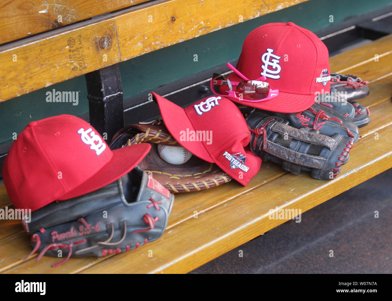 St  Louis Cardinals players hats and gloves sit on the bench