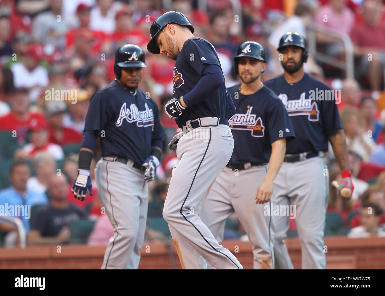 Atlanta Braves teammates wait for Freddie Freeman to touch home plate after he hit a three run home run in the third inning against the St. Louis Cardinals at Busch Stadium in St. Louis on August 6, 2016.    Photo by Bill Greenblatt/UPI Stock Photo