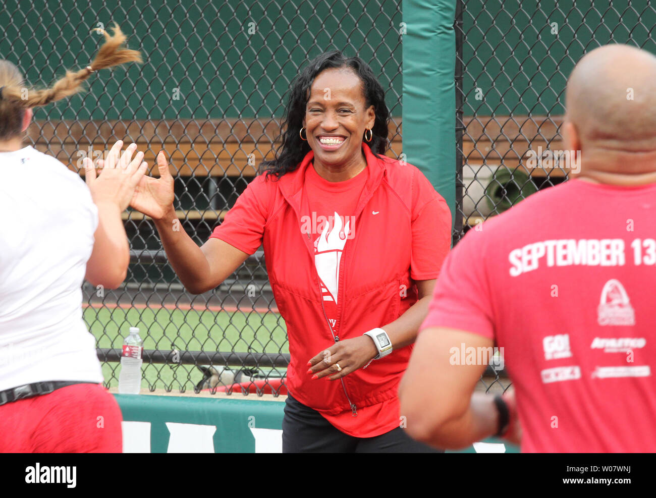 Former Olympic gold metalist Jackie-Joyner Kersee greets runners at the finish line of the 7th Annual Cardinals Care 6K run at Busch Stadium in St. Louis on September 18, 2016.   Photo by Bill Greenblatt/UPI - Stock Image