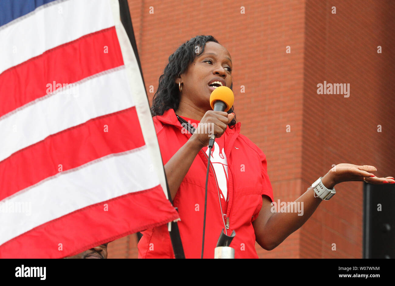Former Olympic gold metalist Jackie-Joyner Kersee addresses runners before the start of the 7th Annual Cardinals Care 6K run at Busch Stadium in St. Louis on September 18, 2016.   Photo by Bill Greenblatt/UPI - Stock Image