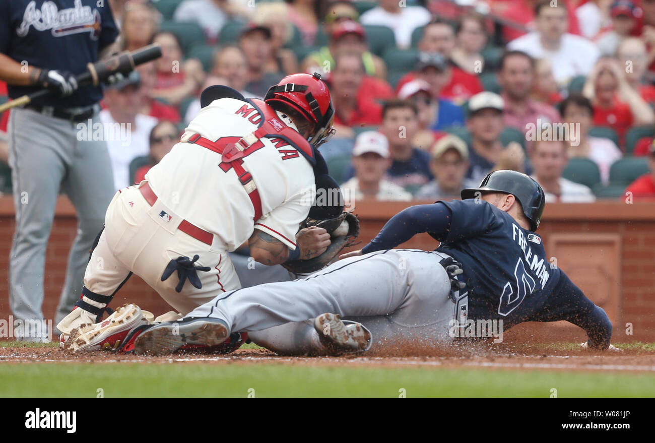 Atlanta Braves Freddie Freeman slides into home plate under the tag of St. Louis Cardinals catcher Yadier Molina in the first inning at Busch Stadium in St. Louis on August 12, 2017. Photo by Bill Greenblatt/UPI Stock Photo