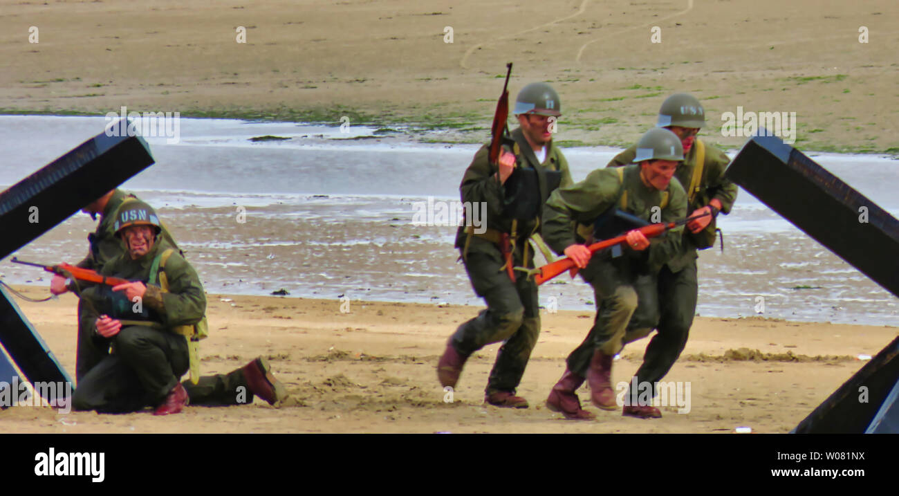 UTAH, FRANCE - June 06, 2019. Special forces men in camouflage uniforms on beach. Diversionary mission for D-Day 75 birthday, end of world war two Stock Photo