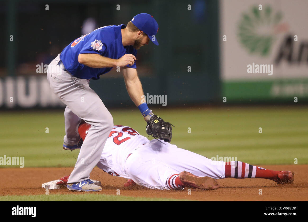 St. Louis Cardinals Tommy Pham slides under the late tag by Chicago Cubs Mike Freeman, stealing second base in the sixth inning at Busch Stadium in St. Louis on September 28, 2017. Photo by Bill Greenblatt/UPI Stock Photo