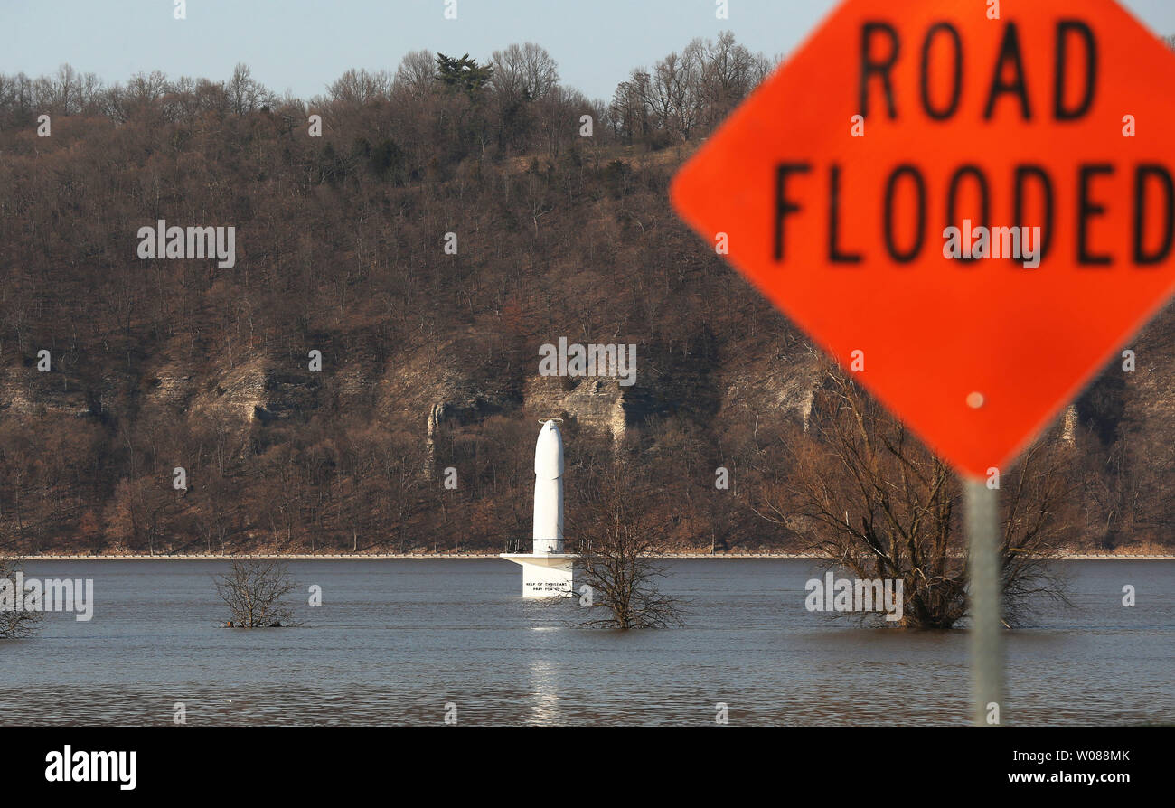 The shrine of Our Lady of the Rivers, is impossible to get to due to the rising Mississippi River over the road in Portage Des Sioux, Missouri on April 2, 2019.  The Mississippi River is at 38 feet in St. Louis, reaching moderate flooding stage. Major flooding occurs at 40 feet. Photo by Bill Greenblatt/UPI Stock Photo