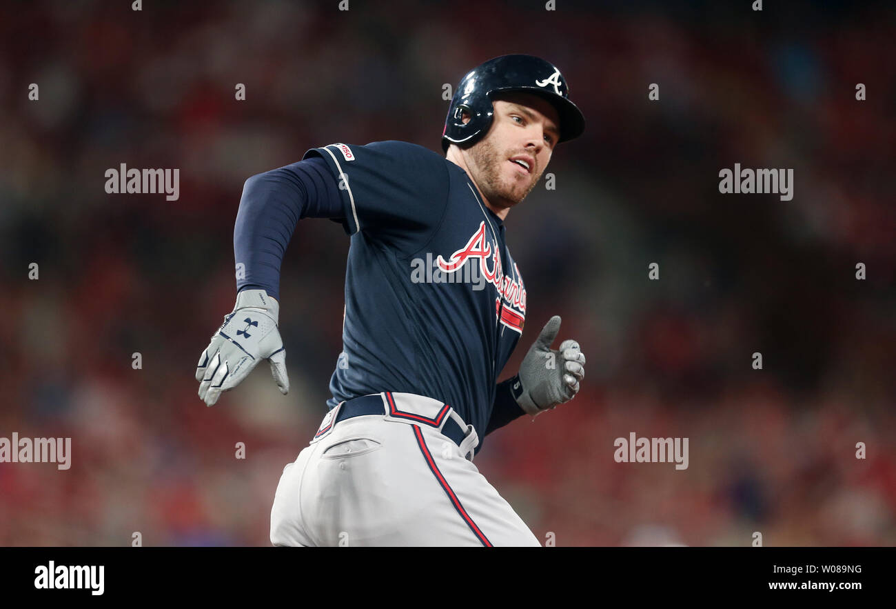 Atlanta Braves Freddie Freeman looks back at first base coach Eric Young, Jr. after hitting a solo home run in the sixth inning against the St. Louis Cardinals at Busch Stadium in St. Louis on May 24, 2019. Photo by Bill Greenblatt/UPI Stock Photo